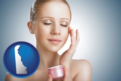 delaware a woman applying skin cream to her face