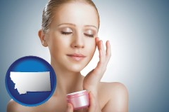 montana a woman applying skin cream to her face