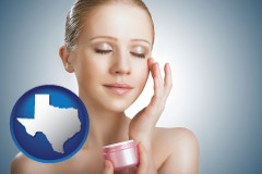 texas a woman applying skin cream to her face
